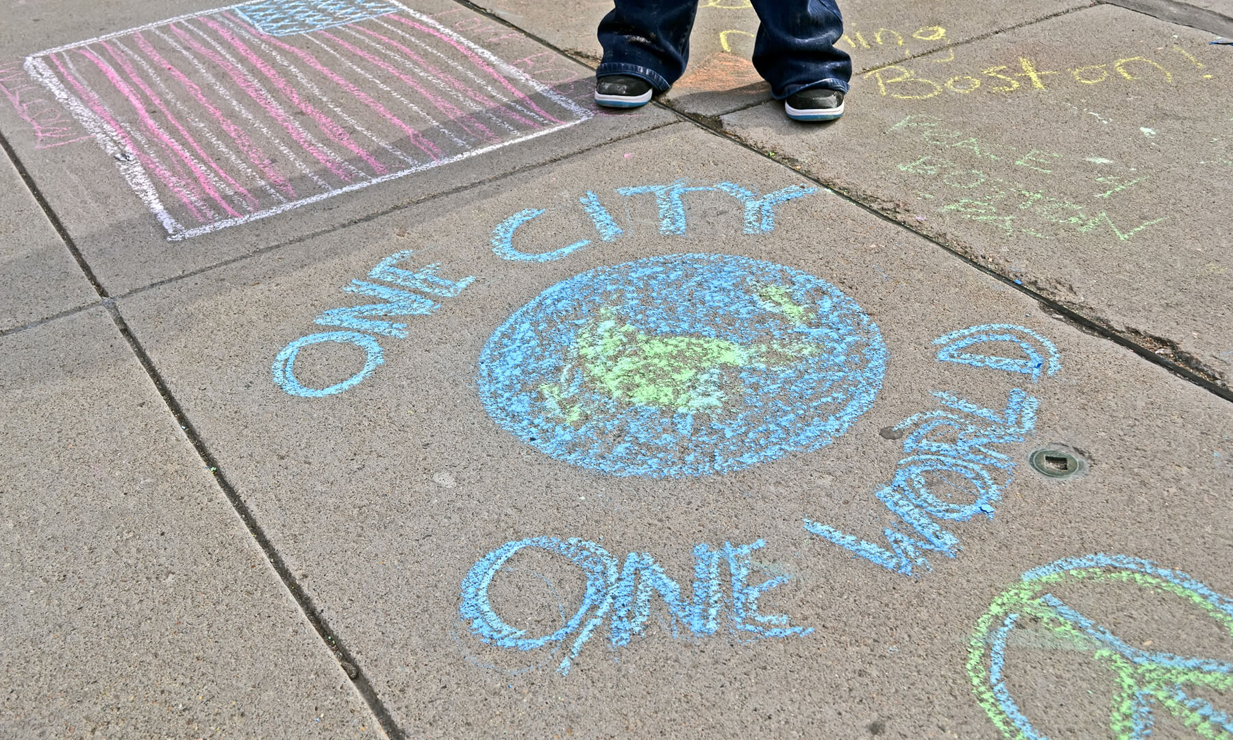 One City One World sidewalk chalk - activism - art - diversity - unity
