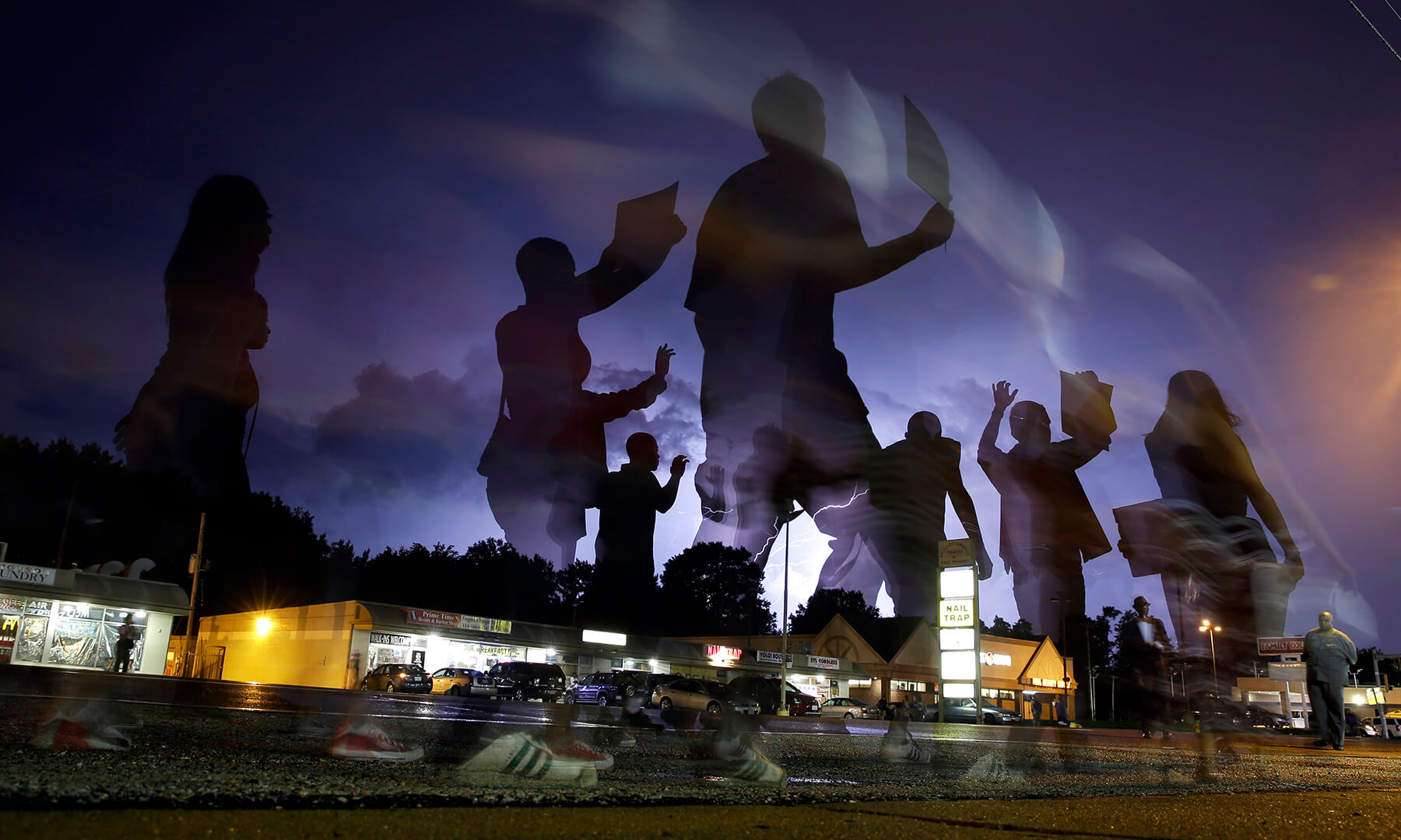 protesters march in Ferguson, MO after Michael Brown was fatally shot