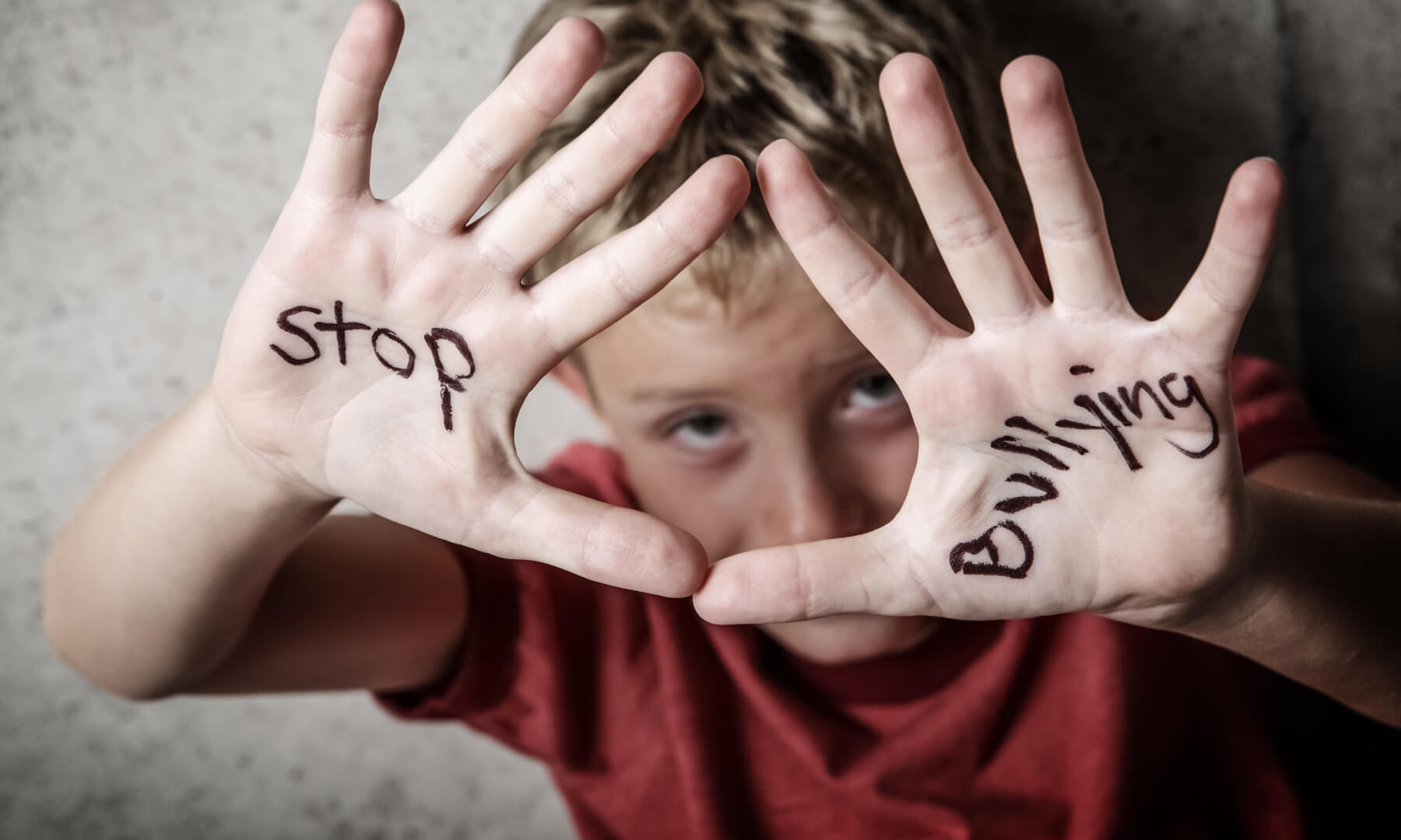 Student with stop bullying written on hands