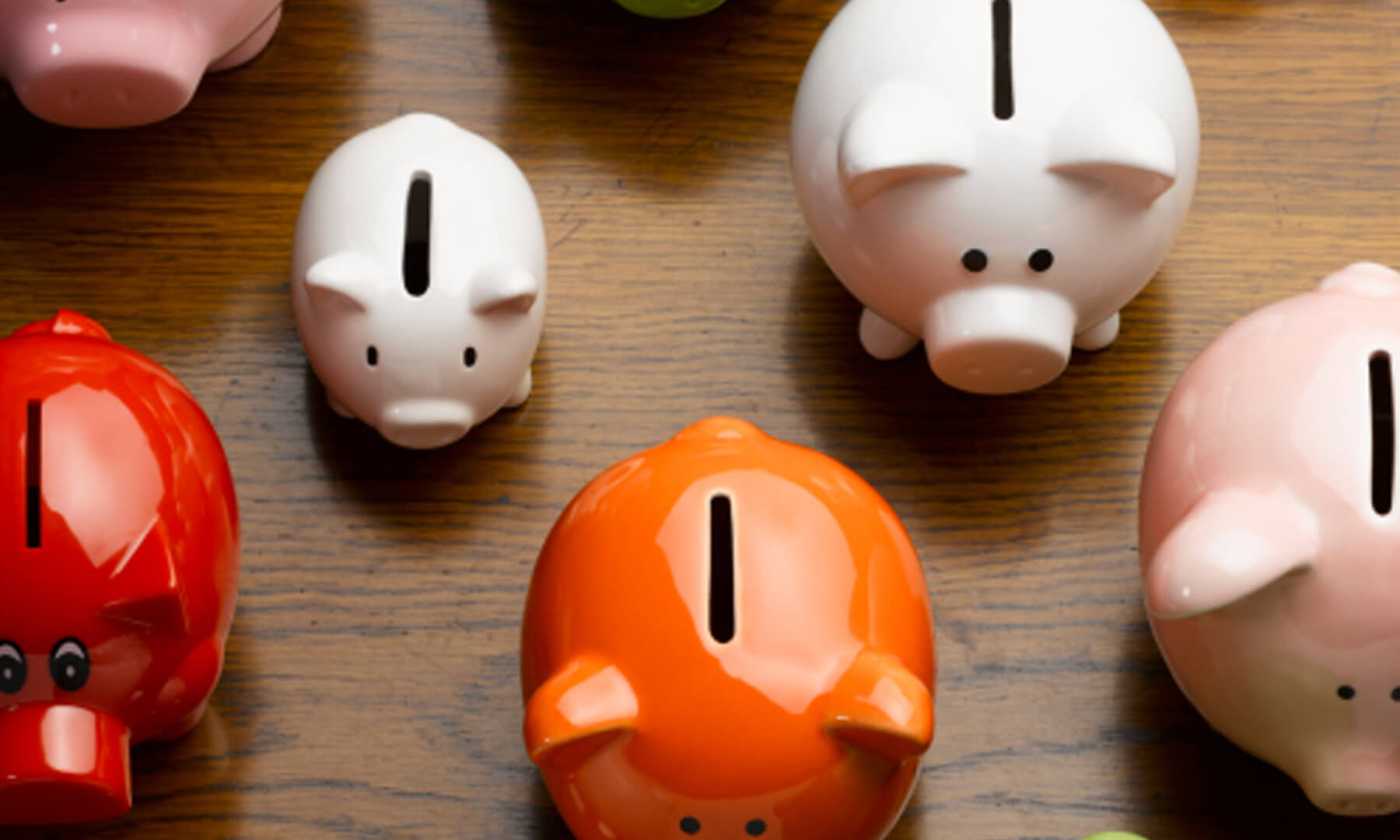 different colored piggy banks on floor
