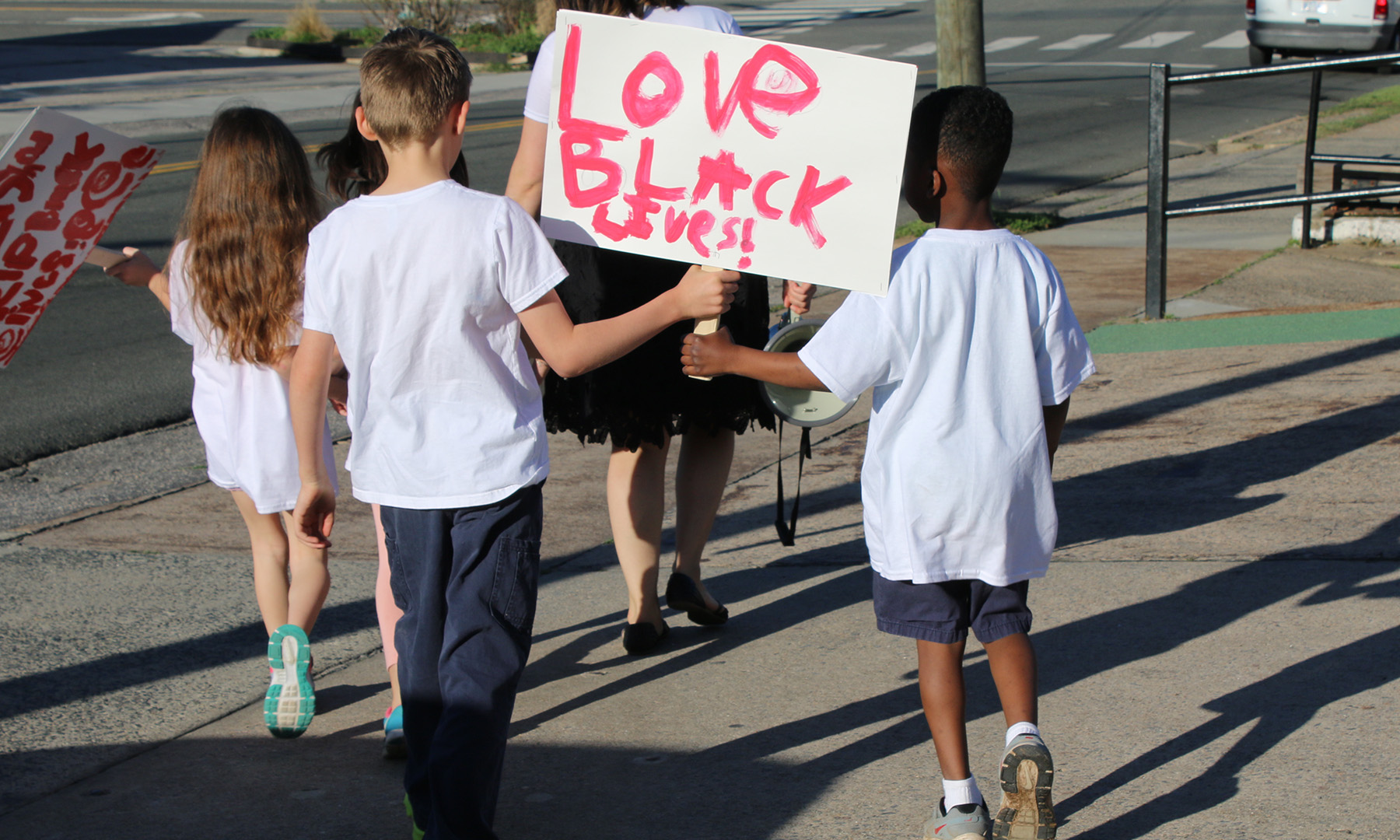 Students marching with Black Lives Matters sign