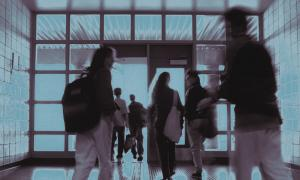 Out of focus photo of students walking on school halls