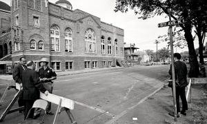 A STATE TROOPER GUARDS A ROAD BLOCK AT THE 16TH STREET BAPTIST CHURCH THE DAY AFTER THE BOMBING.