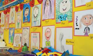Children's self-portraits hanging on a wall