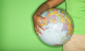 student holding a globe