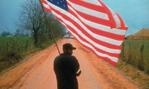 Man carrying the American flag