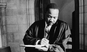MLK writing in pastoral robe
