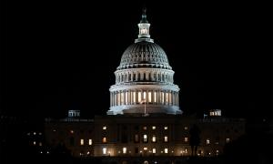 The United States Capitol building illuminated at night.