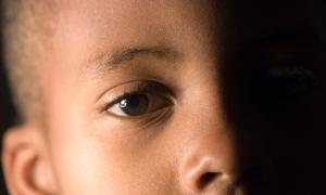 Close up of young African-American child.