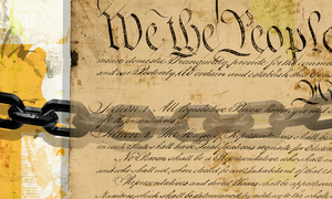 Chains superimposed over an image of the United States Constitution.