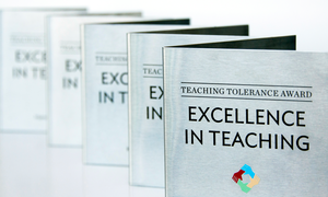 A photo shows awards given for the Teaching Tolerance Award for Excellence in Teaching.