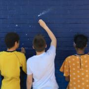 Students painting wall | TT Grants Spotlight
