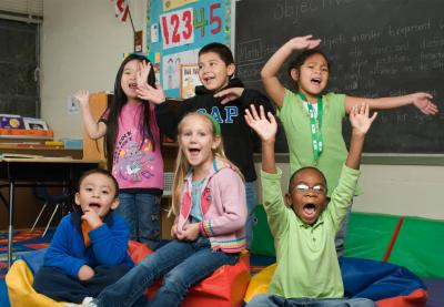 kids posing excitedly in classroom