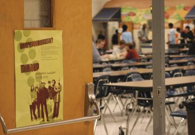 Mix It Up poster at a school cafeteria door, while students eat in the background