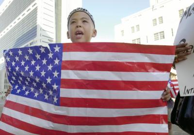 Student holding a US flag