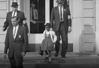 Ruby Bridges walks down the stairs of the schoolhouse