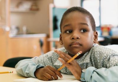 student with pencil thinking