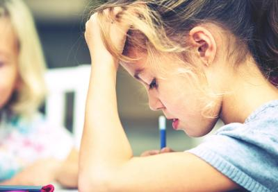 girl concentrating on school work