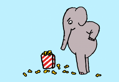 Elephant looking disapprovingly at a box of peanuts on the ground