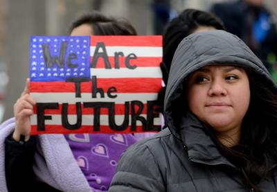 "Woman at rally holding sign with caption ""We Are the Future"""