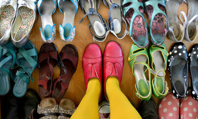 assortment of shoes person standing in pair in middle