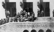 Soldiers escort black students into the front door of Little Rock Central High School.