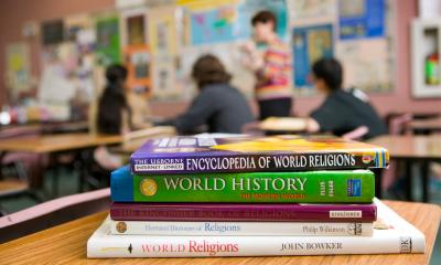 Stock of books about religion inside a classroomi