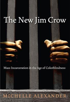 The New Jim Crow cover, hands grasped around prison bars