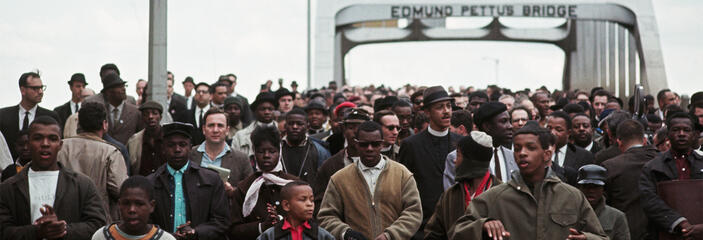 Civil Rights Movement activists marching over the Edmund Pettus Bridge.