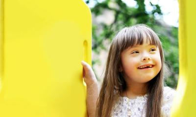 girl on yellow playground equipment