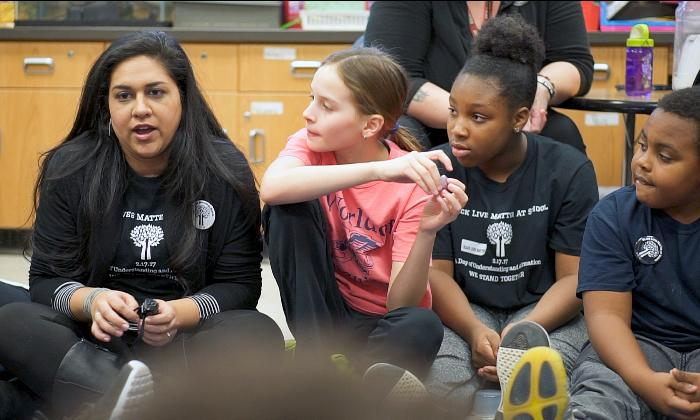 A teacher at Rochester City School district leads discussion with her students.