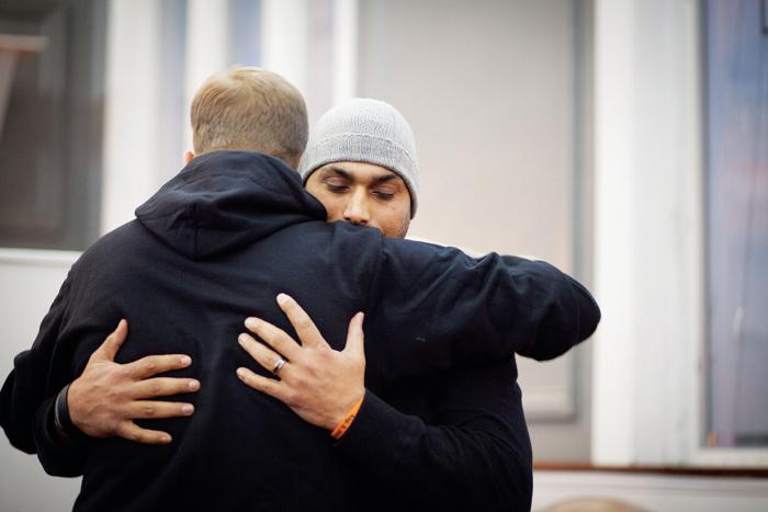 Social study teacher Pardeep Kaleka hugs Arno Michaelis anti-racist activist