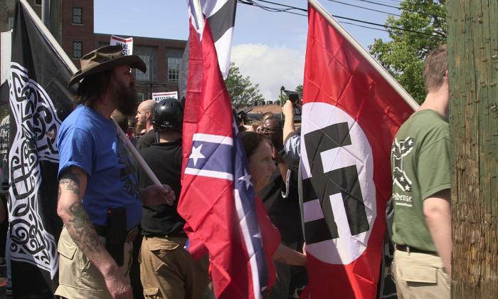 Demonstrators hold shields and flags during the Unite the Right free speech rally at Emancipation Park in Charlottesville, Virginia, USA on August 12, 2017.