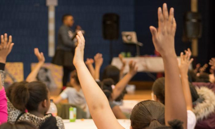 Raised Hands | Love Your Magic Conference | Teaching Tolerance Grantee Project
