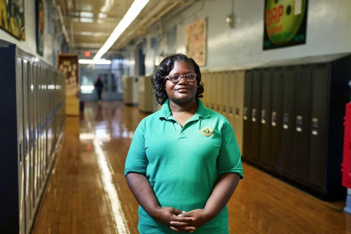 Educator LaKeshia Myers standing in the school hallway