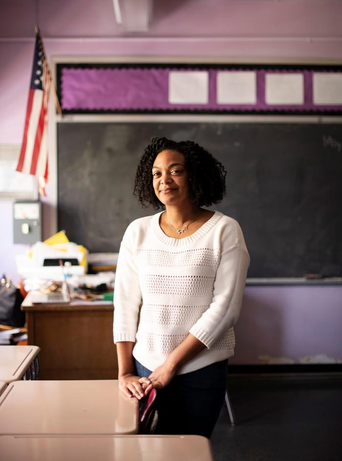 Educator LaKeshia Myers standing in a classroom