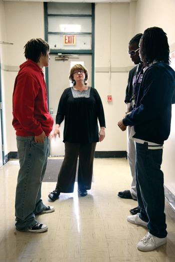 Vickie Malone stands with students in the hallway